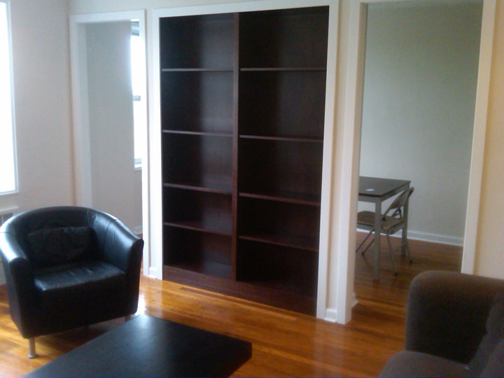 This bookcase was built-in with the wall to divide a large room so that an additional sleeping area could be created. I worked with the owner to accomplish a division but yet maintain an open feel.