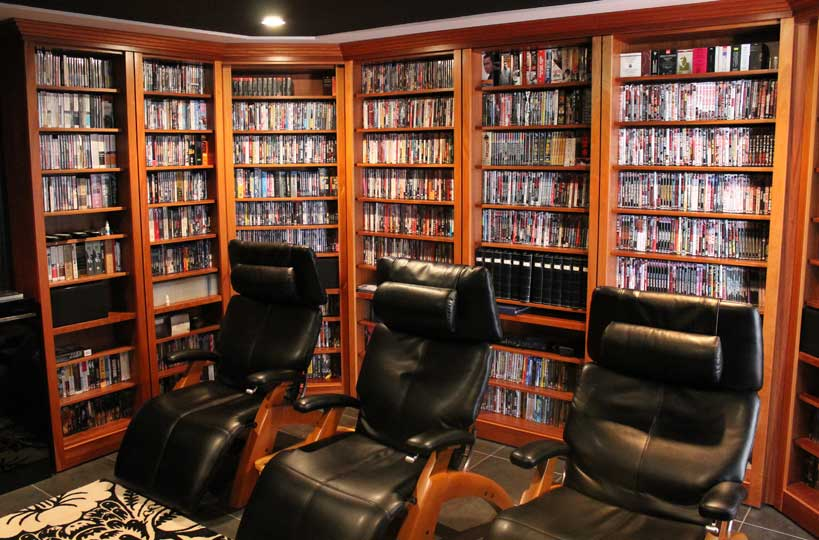 Mahogany Media Room. Our client is a movie fanatic and needed a room completely set up for his addiction. One of the bookcases opens up to reveal a hidden room behind! He is a very happy camper!